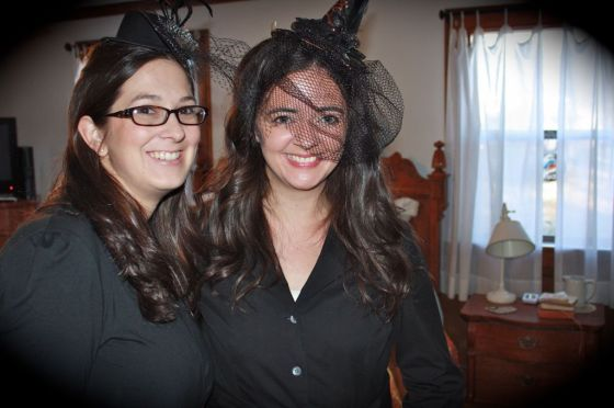 Funny...Amy and I dressed in all black and wore funny hats and accessories with absolutely NO intention of looking like witches. But we totally look like witches.